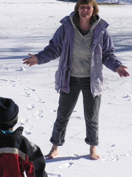 My barefoot sister on our frozen lake in Sweden